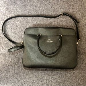 Coach black leather laptop bag, tags, and strap